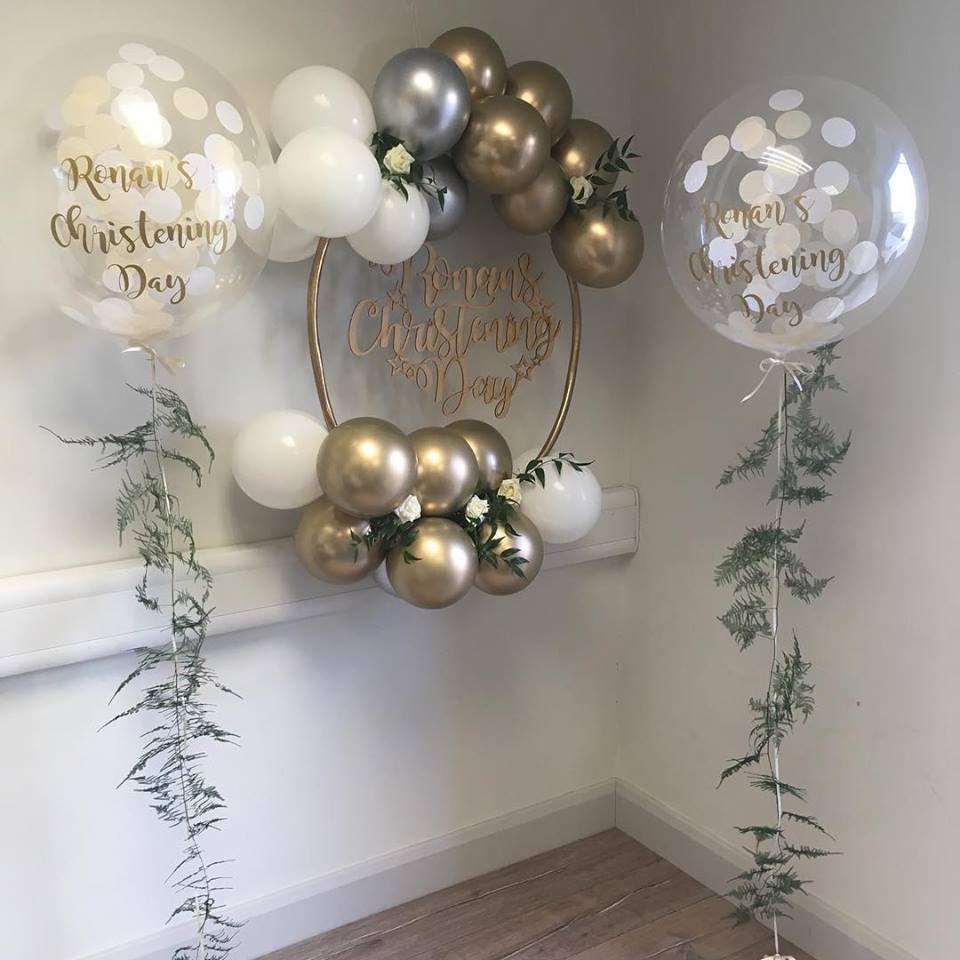 christening confetti bubble balloons with fern tail and balloon hoop cluster