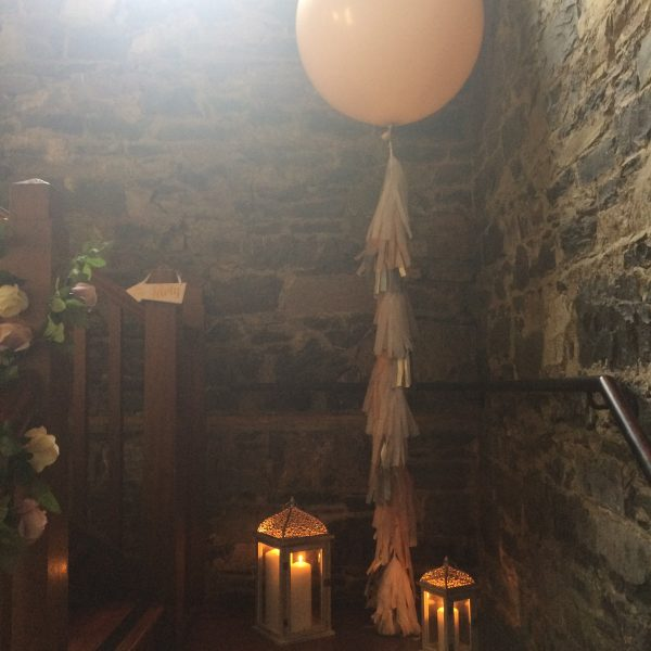 3ft balloon with tassel tail on stairs