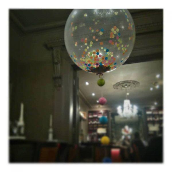Colourful confetti balloon pom pom tail