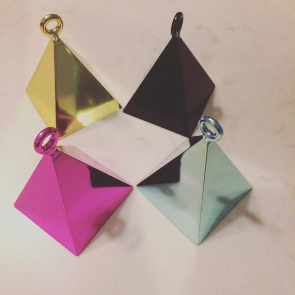 Pyramid balloon weights.