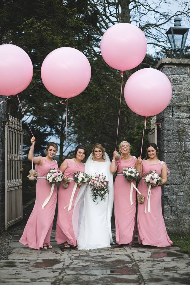 bridal party with giant pink balloons