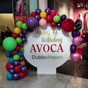 balloon circle backdrop with coloured balloons