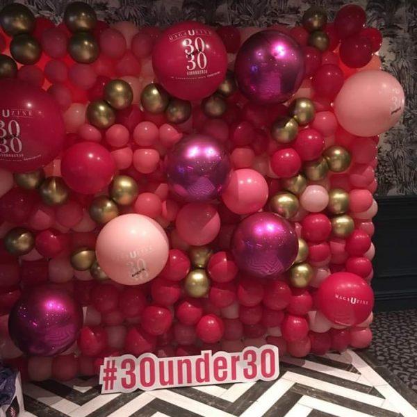 30 under 30 balloon wall pinks