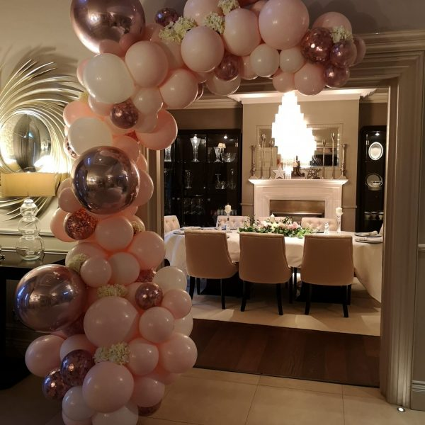 half balloon arch pink and rose gold
