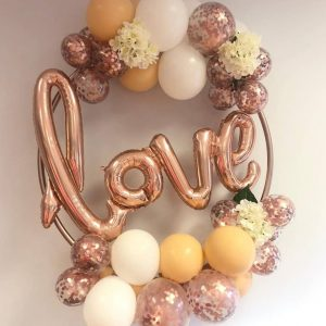 balloon hoop with love balloon centre and rose gold balloons