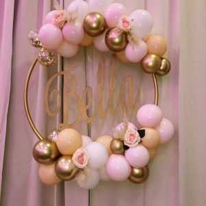 balloon hoop with woodern insert and gold and pink balloons