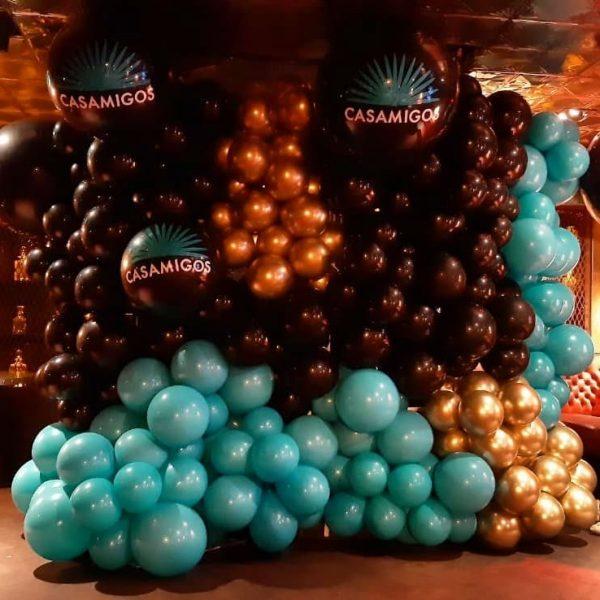 balloon wall black gold and light blue casamigos