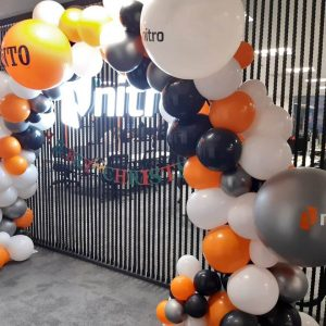 full balloon arch with branding