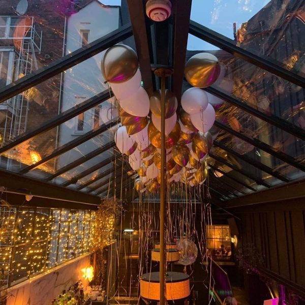 gold and white ceiling balloons