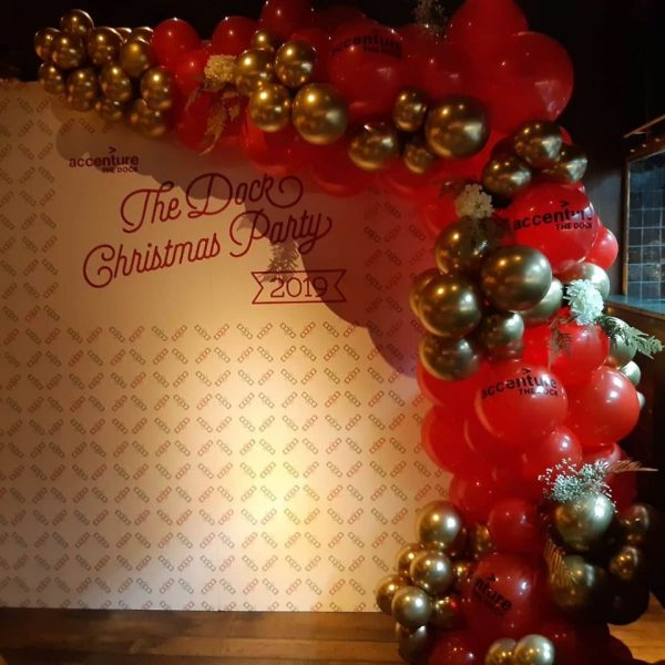 half balloon arch gold and red with branding