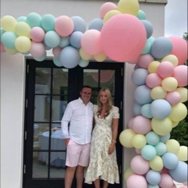 half balloon arch pastel outdoors