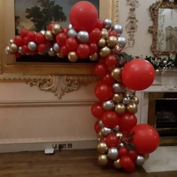 half balloon arch silver gold and red balloons