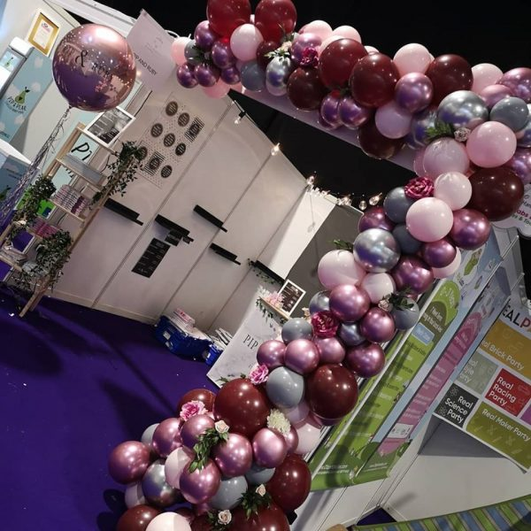 half balloon arch with flowers