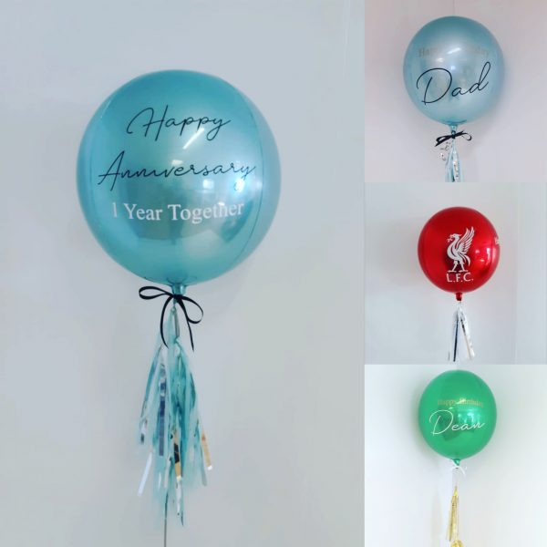light blue and silver orbz balloon