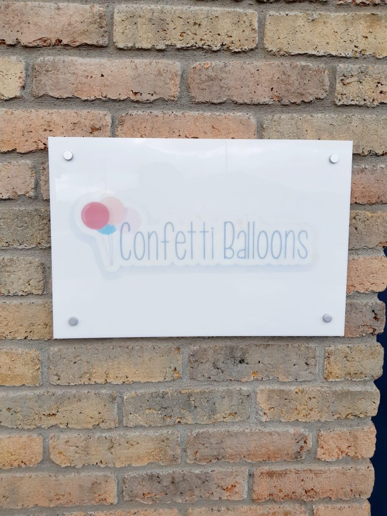 confetti balloons outside signage
