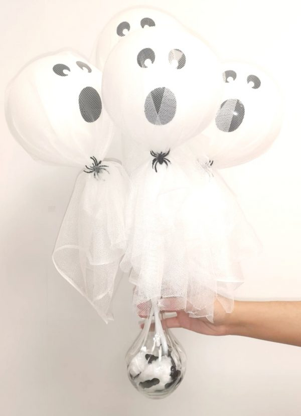 ghost balloon wands in vase