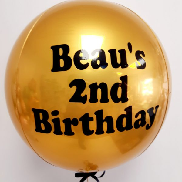 happy birthday gold balloon with black text