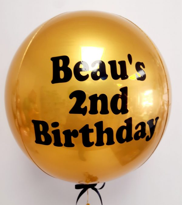 happy birthday gold balloon with black text