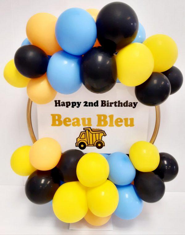 light blue, yellow, and black balloon hoop