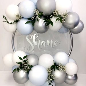 pastel blue and silver and white balloon hoop with flowers