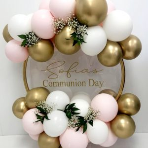 pastel pink and gold and white balloon hoop with flowers
