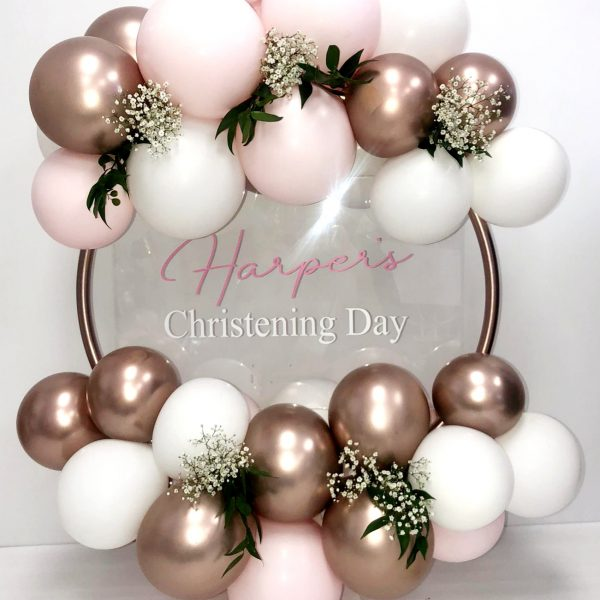 pastel pink and rose gold balloon hoop with flowers