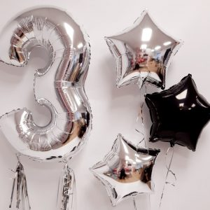 inflated silver balloon package close