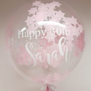 confetti bubble balloon pink and white stars