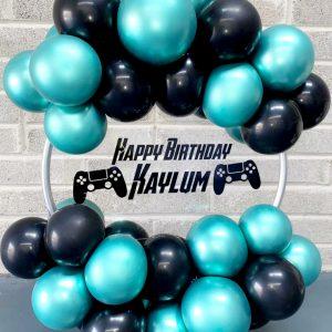 green and black balloon hoop
