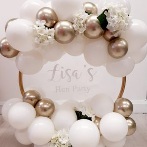 white and gold balloon hoop