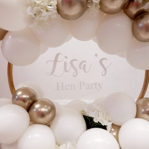 white and gold balloon hoop close up
