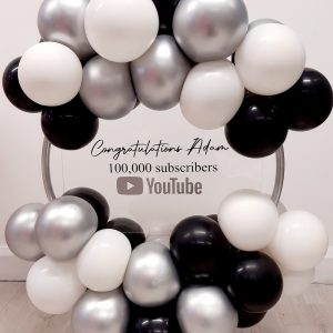 white black and silver balloon hoop with stand