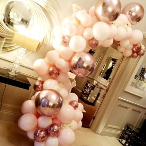 half balloon arch pastel pink and rose gold