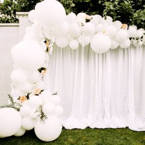 half balloon arch white with flowers