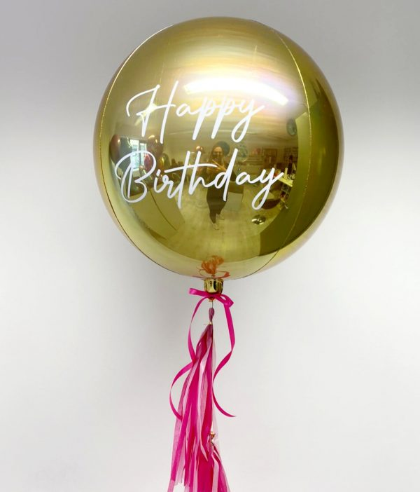 white gold orb balloon with tassel tail