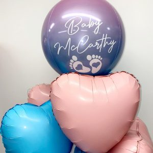 gender reveal balloon bunch with orb close up